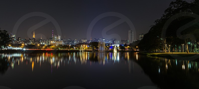 night view of city and sea photo