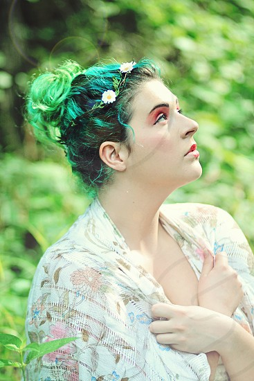 woman with green hair and erd eye shadow photo