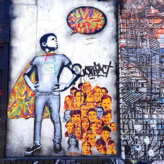 man with cape graffiti photo