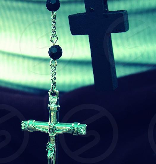 silver-colored crucifix pendant photo