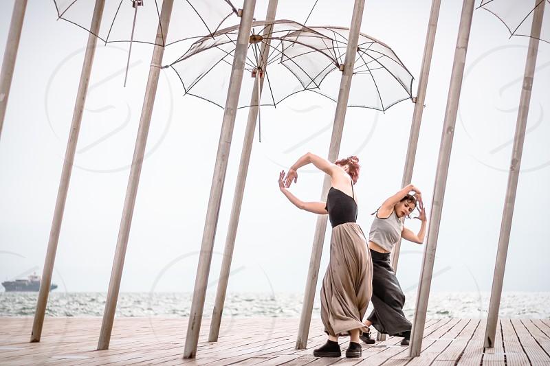 Female Dancers On The Dock photo