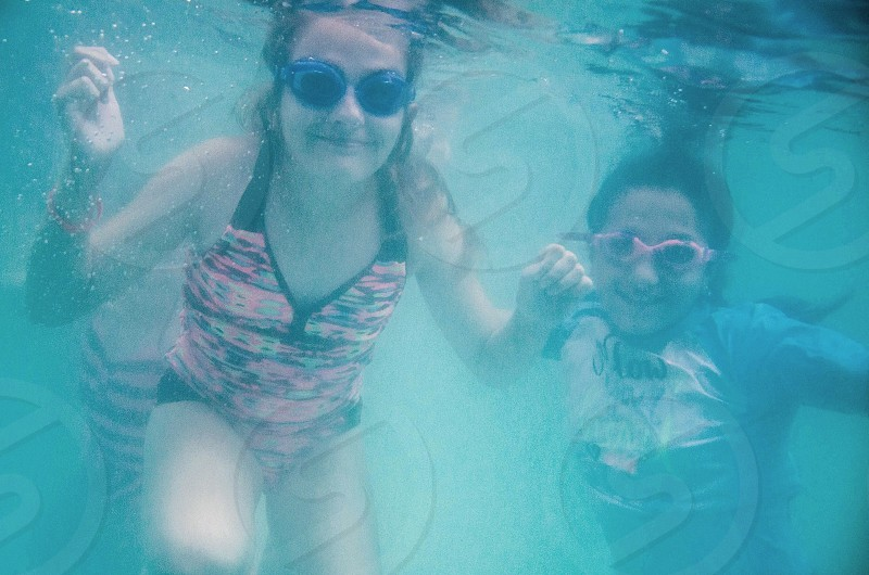 People under water photo