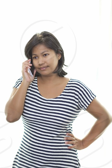 Business look Asian lady standing and talking on the phonebright light white backgroundcopy spaceclipping photo