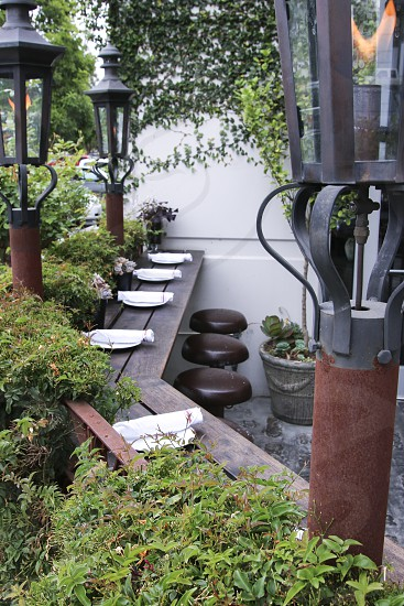 Outdoor patio at ARC with gas lamps - vertical photo