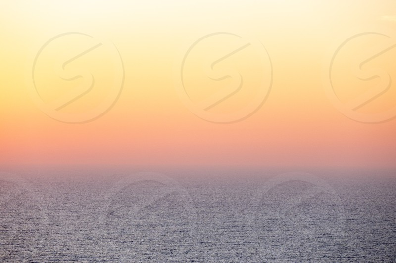 Amazing sea landscape with a gentle soft sunrise with a pink haze against the rising sun. photo