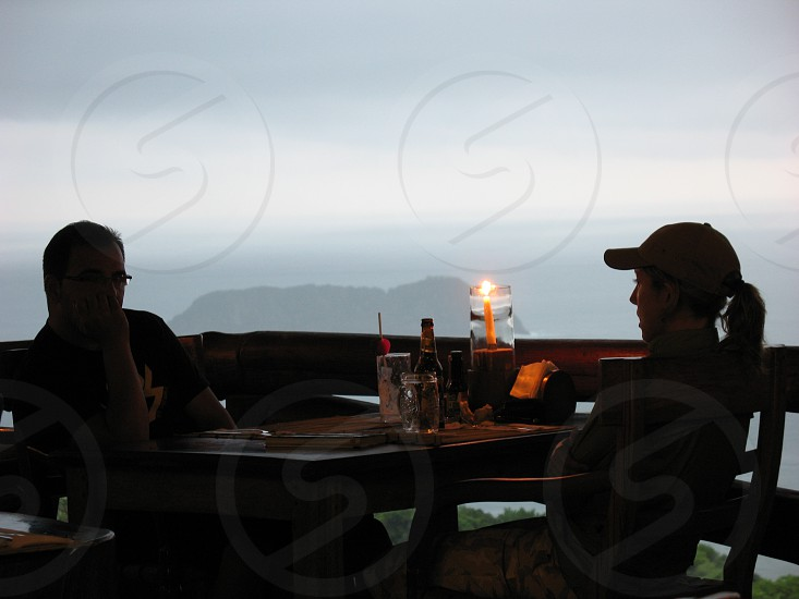 Couple at candlelit table coast of Costa Rica photo