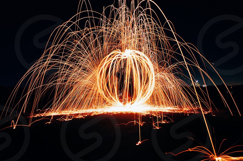 person using fireworks photo