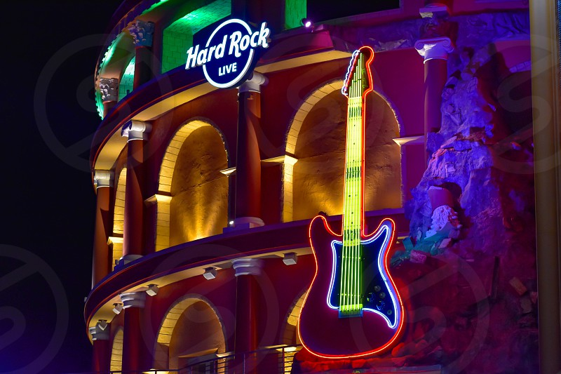 Orlando Florida. February 05 2019.  Hard Rock Live sign and illuminated guitar on colorful building background in Citywalk at Universal Studios area. photo