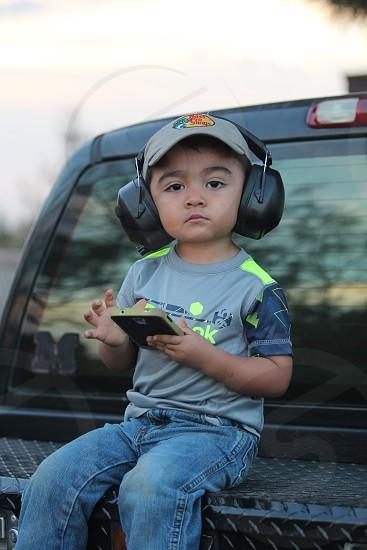truck boy children jeans headphones smartphone phone noise guns photo