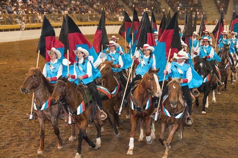 Horseback flag parade at National Western Stock Show in Denver Colorado photo
