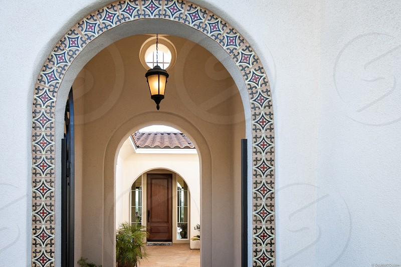 A luxurious family home in Southern California. House residence neighborhood suburban property door arch.  photo
