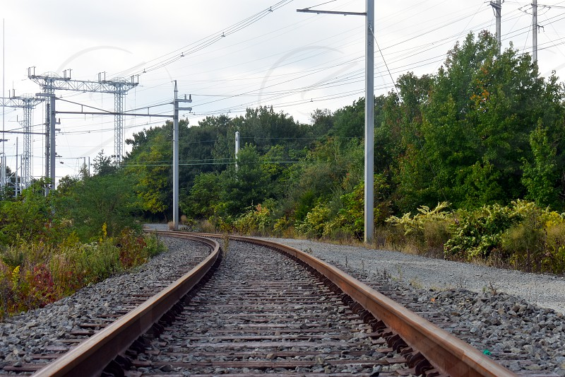 Steel rail road tracks over crushed stones  disappearing in the distance (3) photo
