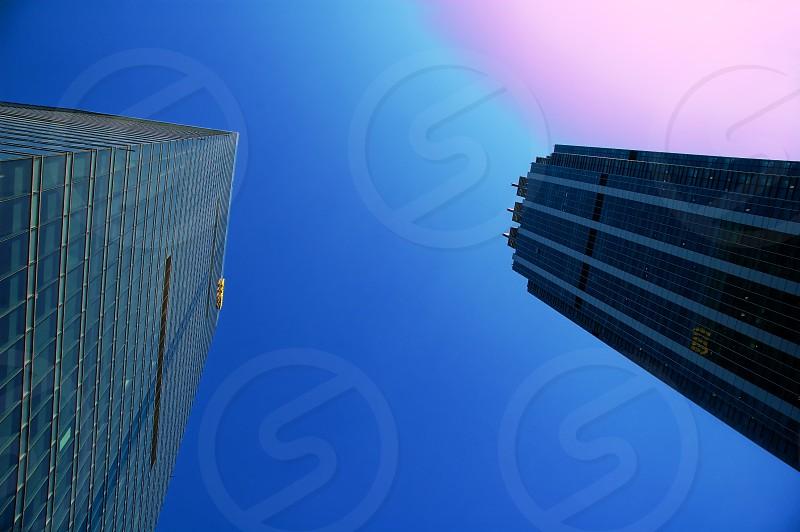 modern office skyscraper building ove blue sky photo