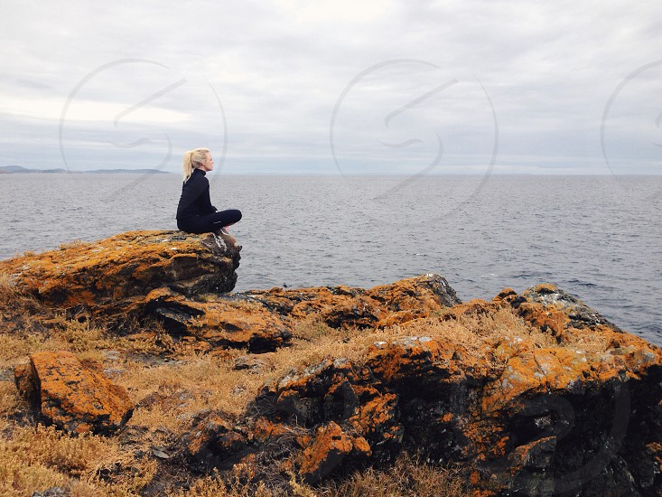 woman sitting on mountain photo