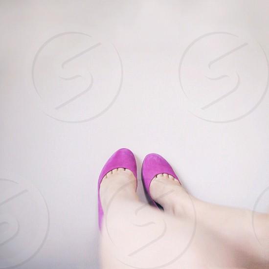 Looking down legs minimal feet pink feminine shoes  photo