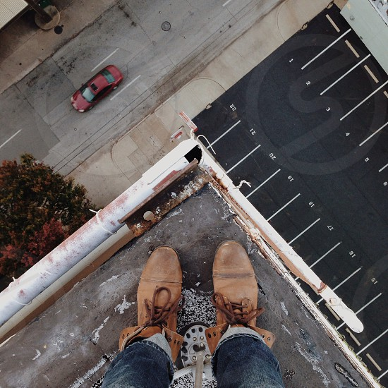 feet on rooftop photo