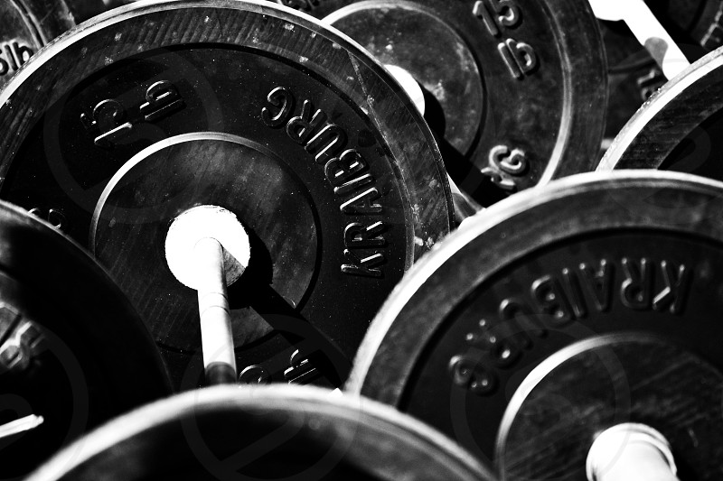 Gym fit fitness gym equipment equipment plates weights abstract monochrome minimal art photo