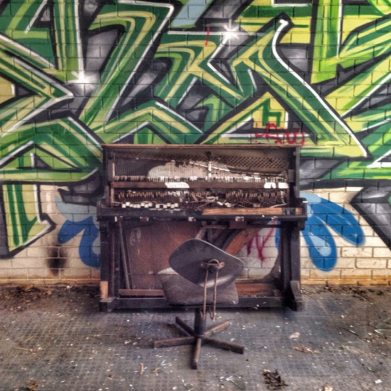 wreaked chair and piano in abandoned room photo