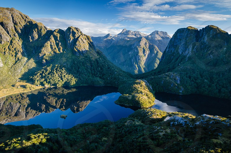 Lake Norwest and the mountains beyond - aerial shot from Fiordland National Park New Zealand photo