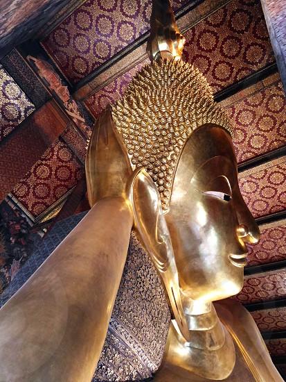 photography of resting Buddha statue photo