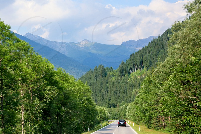 Traveling by car in Europe. The road passes through the picturesque places in the Alps photo