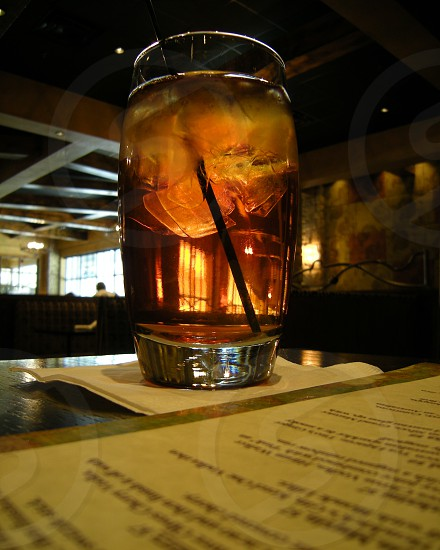 Clear iced tea in glass photo