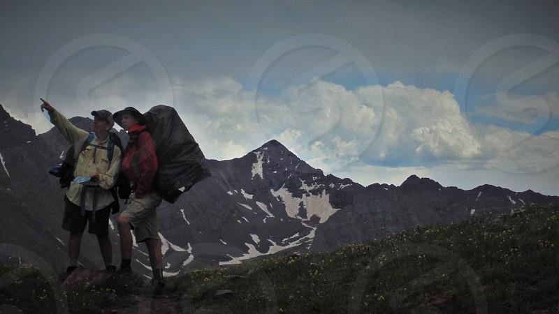 2 mountain climber  on mountain photo