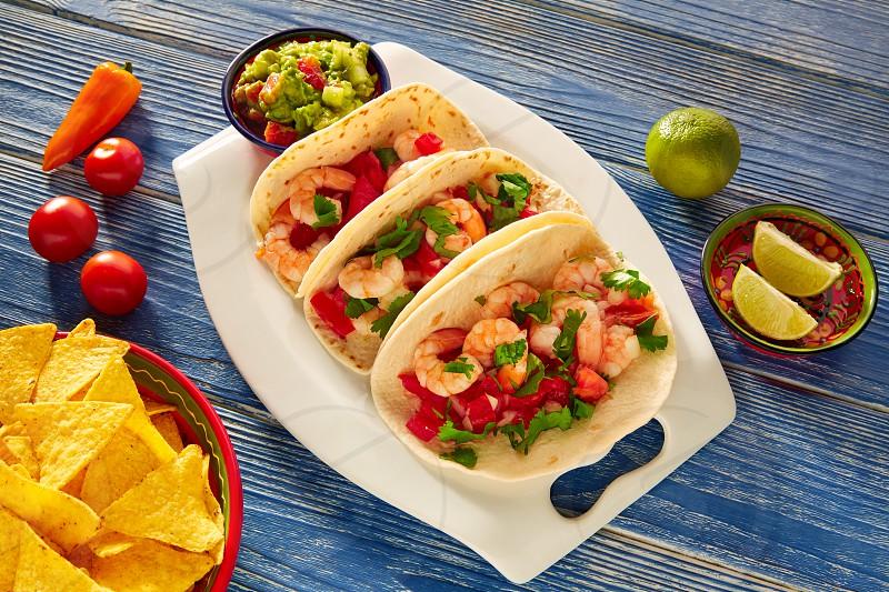Camaron shrimp tacos mexican food on blue wood table photo