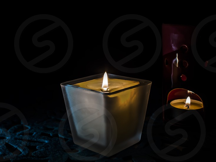 decorative candles on a dark background photo