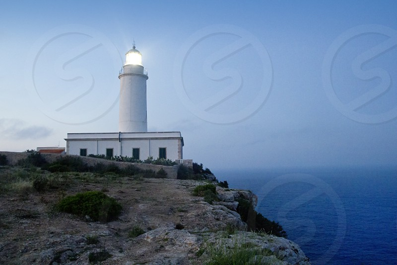 Cape barbaria lighthouse sunset lighting Mediterranean Formentera island photo