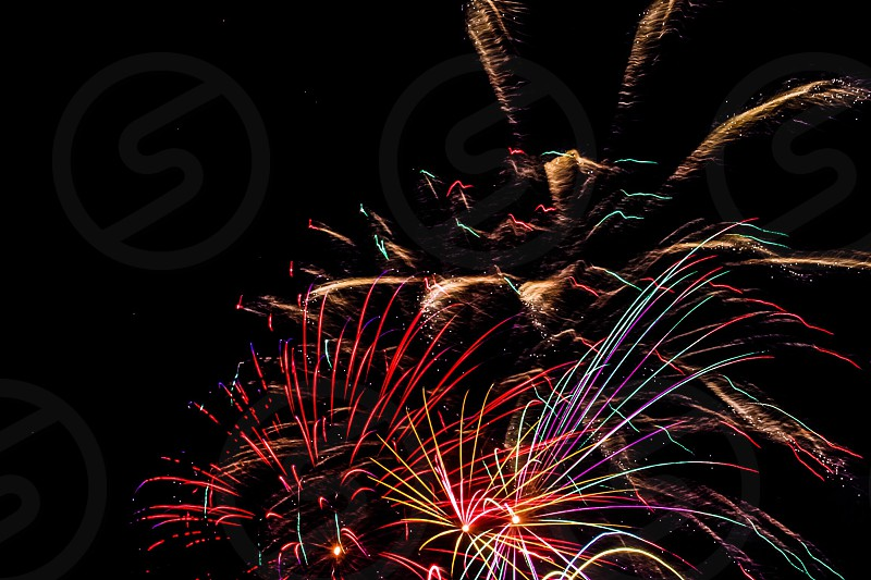 red white gold blue fireworks display photo