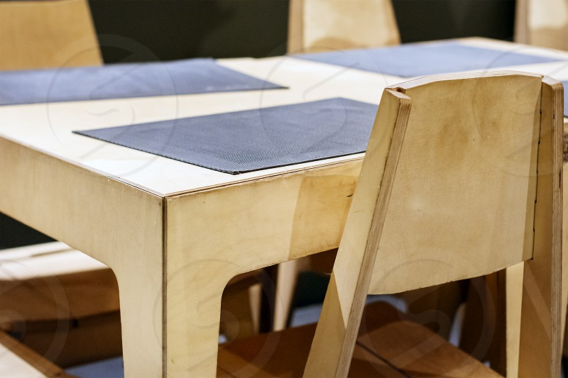 wooden table and chairs in a restaurant. Design furniture. photo