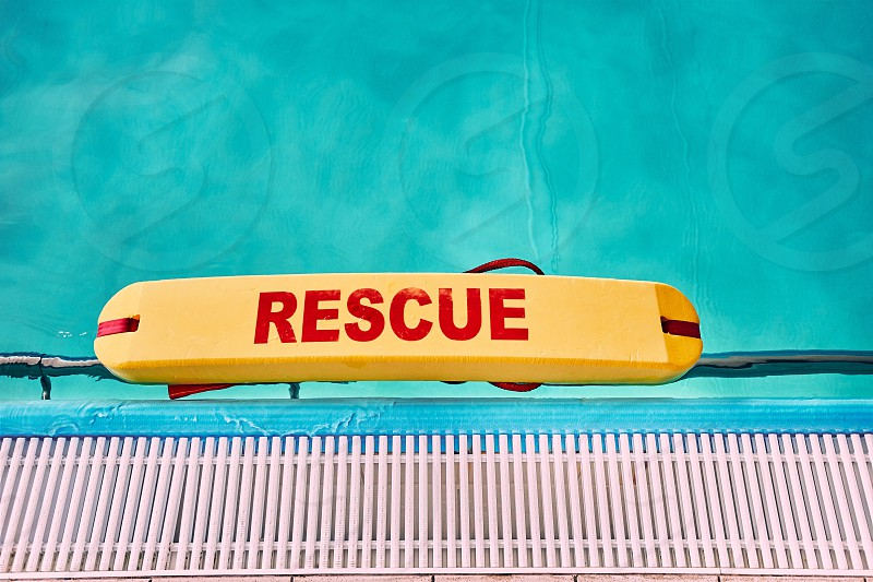 Lifesaver equipment on swimming pool. Candid people real moments authentic situations photo