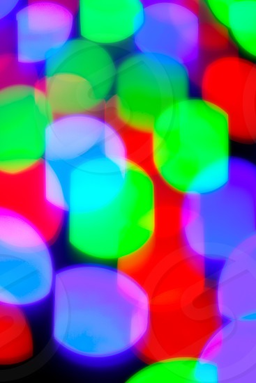 glowing bokeh colorful lights in black background photo