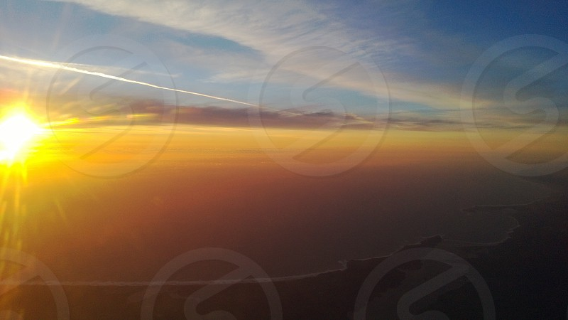 Colorful sunset from the air over the California coast. photo