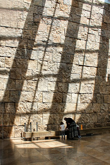 Rectangular shadows   on the stone wall of a museum photo