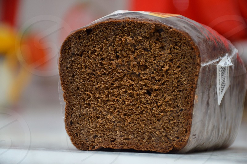 brown bread with clear plastic cover on white surface photo