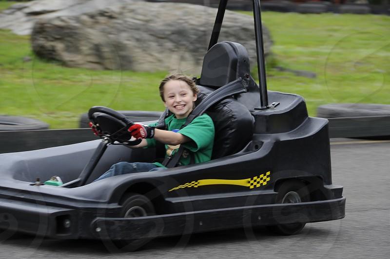 Boy Go Kart Racetrack Speed Motion Blur Exhilaration Fast photo