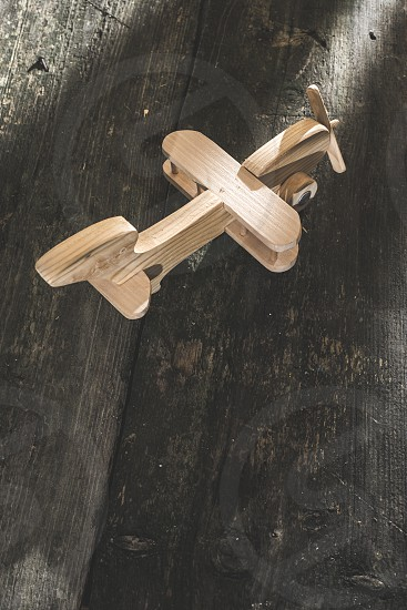 Vintage wooden plane on wooden board. Sunshine through the window photo