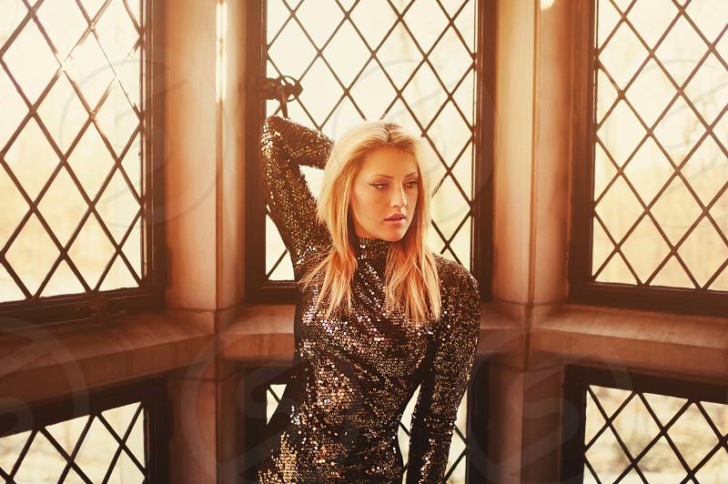 blond hair woman wearing silver long sleeved shirt photo