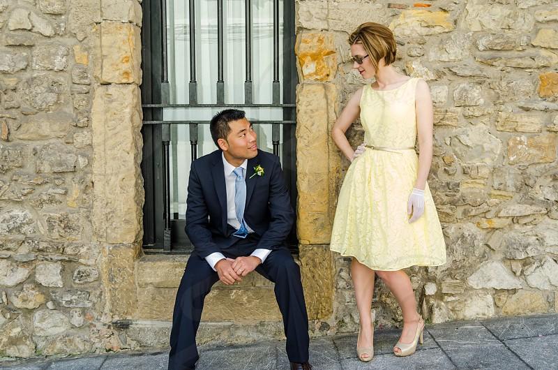 wedding bride fiance interracial chinese caucasian yellow heels city street costume dress gloves photo