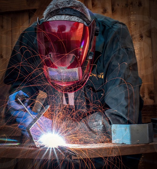 Welder welding arc light sparks photo
