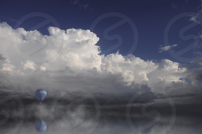 white clouds over the blue parachute photo