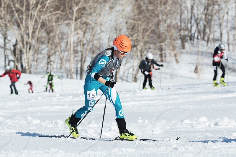 MOUNTAIN MOROZNAYA ELIZOVO KAMCHATKA RUSSIA - APRIL 25 2014: Vertical race. Ski mountaineering Asian Championships Ski mountaineering Russian Championship International competitions ISMF series Kamchatka Race Ski mountaineering Kamchatka Championship. photo