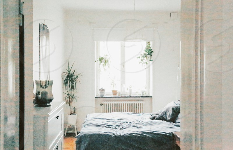 Bedroom bed apartment room window light white walls photo