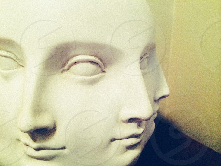 white ceramic human faces photo