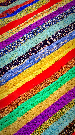 red brown purple blue and yellow striped textile photo