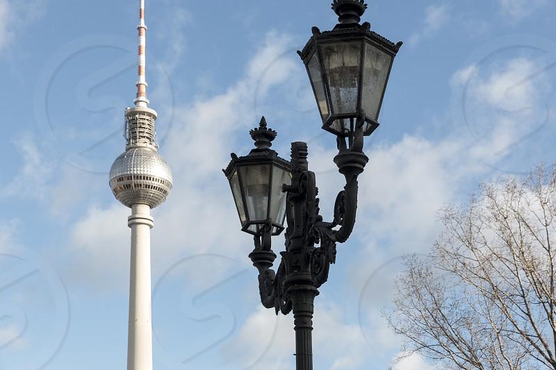 Alexanderplatz - Berlin TV Tower with an old gas light. photo