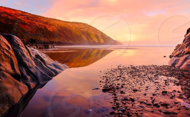Landscape north DevonU.K. rocks sea coast sunset  photo