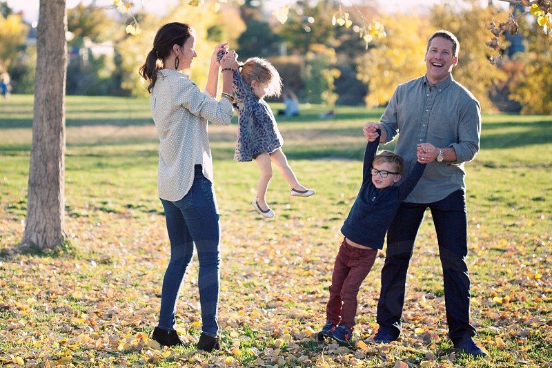 family playing in park photo